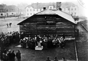 Auschwitz, Poland, The camp orchestra playing for work group http://collections.yadvashem.org/photosarchive/en-us/41668_43277.html